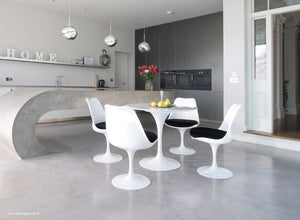 Tulip Marble dining set with black cushions in super modern kitchen