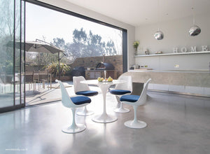 Orangery with small Tulip Marble Table & 4 Tulip Chairs with blue cushions