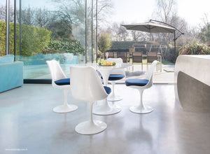 Tulip dining set with chairs in blue with garden and outside view