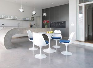 Tulip Marble dining set with blue cushions in super modern kitchen