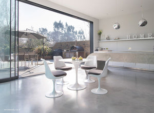Orangery with small Tulip Marble Table & 4 Tulip Chairs with grey cushions