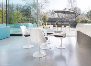 Tulip dining set with chairs in grey with garden and outside view