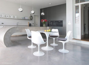 Tulip Marble dining set with grey cushions in super modern kitchen