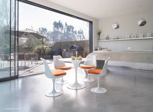 Orangery with small Tulip Marble Table & 4 Tulip Chairs with orange cushions