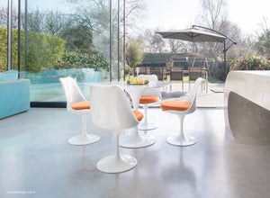 Tulip dining set with chairs in orange with garden and outside view