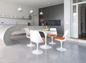 Tulip Marble dining set with orange cushions in super modern kitchen