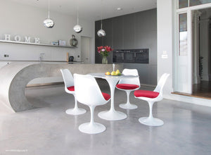 Tulip Marble dining set with red cushions in super modern kitchen