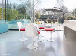 Tulip dining set with chairs in red with garden and outside view