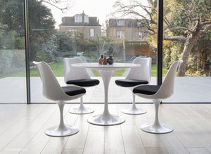 Tulip table and chair set in black shown in a modern kitchen