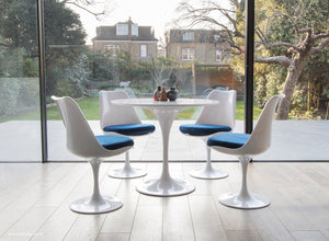 Tulip table and chair set in blue shown in a modern kitchen