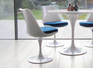 Tulip Chair with blue cushion shown with bi-folding modern doors