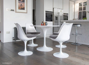 Side view of 90cm Tulip Table and 4 Tulip Side Chairs with grey cushions