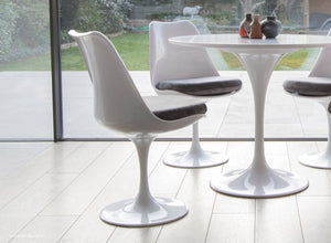 Tulip Chair with grey cushion shown with bi-folding modern doors