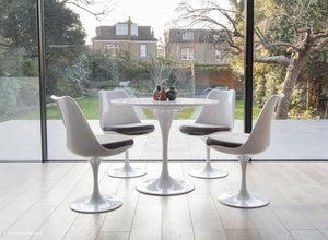 Tulip table and chair set in grey shown in a modern kitchen