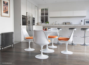 Main view of 90cm Tulip Table and 4 Tulip Side Chairs with orange cushions