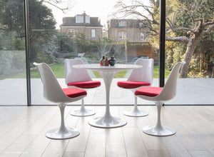 Tulip table and chair set in red shown in a modern kitchen