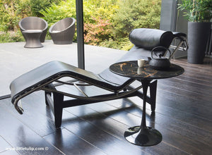 The wonderful Saarinen Tulip Side Tables, in a natural black Italian Portoro Marble finish