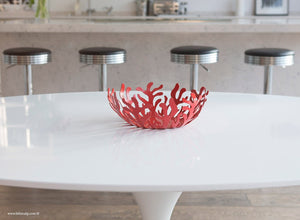 Close up of the 170cm white laminate oval Tulip Table with fruit bowl