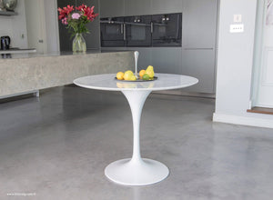 Side view of the Carrara Marble 90cm Tulip Table