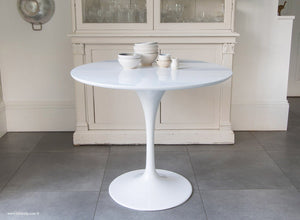 Side view of the white laminate 90cm Tulip Table