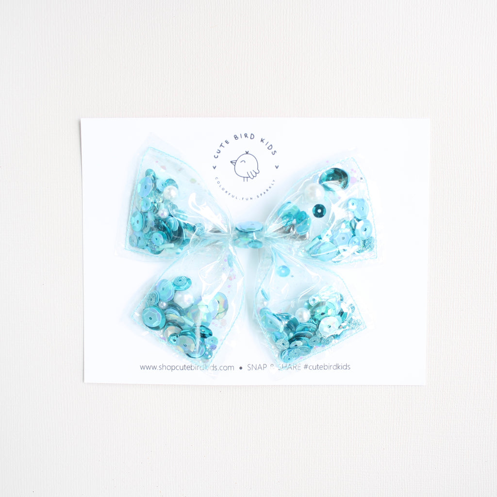 GLITTER SEA Clear Laraline Bow