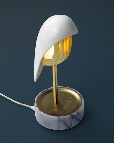 Alarm clock white porcelain bird with gold accents and white marble base wakes up with bird sound works with an app
