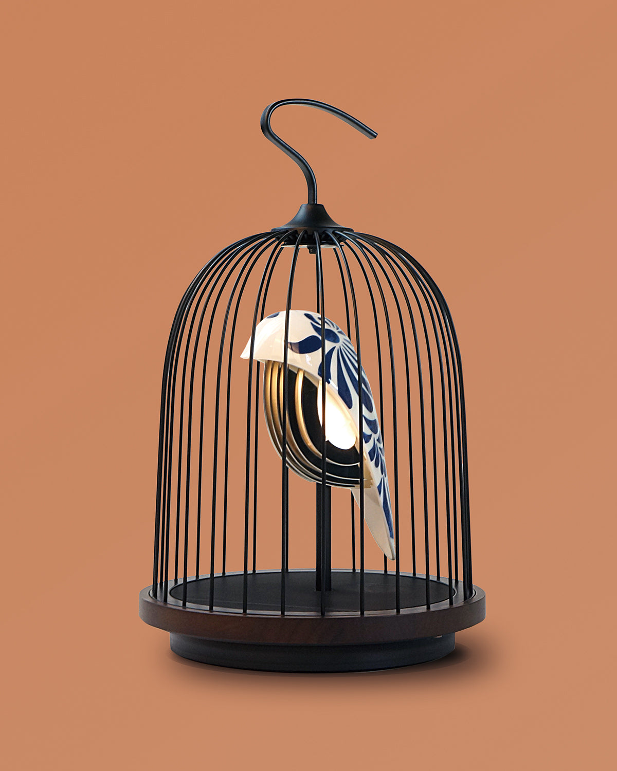 Bluetooth Speaker and Light white porcelain bird with navy blue feather pattern gold accents black cage and walnut color speaker base