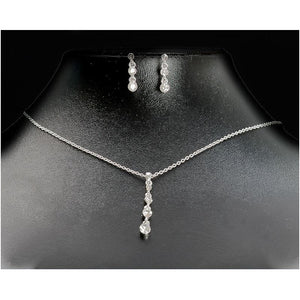Elegance necklace with a central crystal drop & matching earrings.
