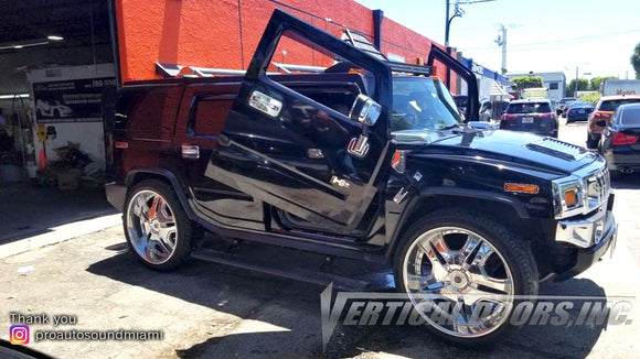 Installer | Pro Auto Sound Miami | Miami, FL | Hummer H2 featuring Verical Doors, Inc. vertical lambo door conversion kit.