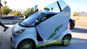 Aleta's 2008 Smart Fortwo featuring Vertical Doors, Inc. vertical lambo doors conversion kit.
