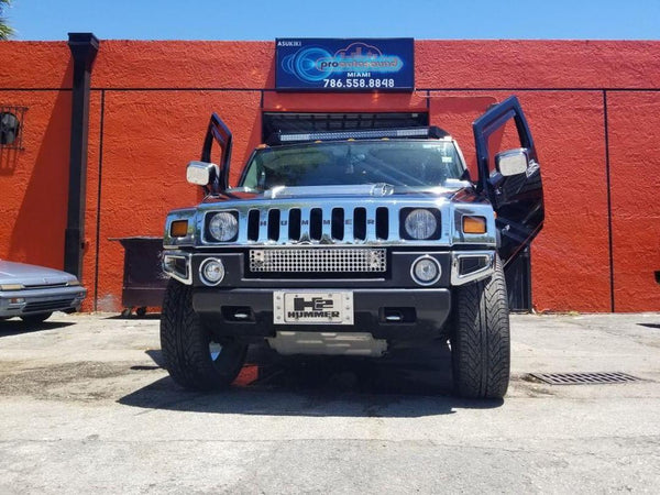 Pro Auto Sound Miami FL Hummer H2 featuring Verical Doors, Inc., vertical lambo door conversion kit.