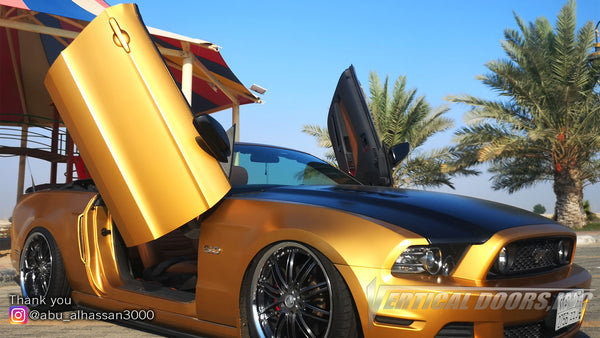 Check out Ali's 5th Gen Mustang GT convertible from Saudi Arabia featuring Vertical Doors, Inc., vertical lambo doors conversion kit.