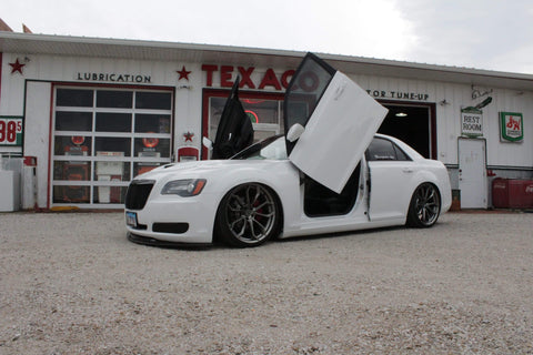 Check out Jamie's Chrysler 300 featuring Front and Rear Vertical Lambo Doors from Vertical Doors, Inc.