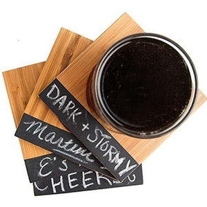 Glass of whisky on bamboo coaster stack labelled dark stormy cheers for entertaining