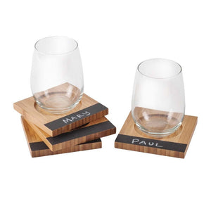 Wine glasses on eco friendly bamboo coaster with chalkboard label saying guest name