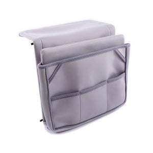 Organizer for laptop, tablet, phones tv remotes that tucks under mattress for bedside storage in neoprene and metal frame.
