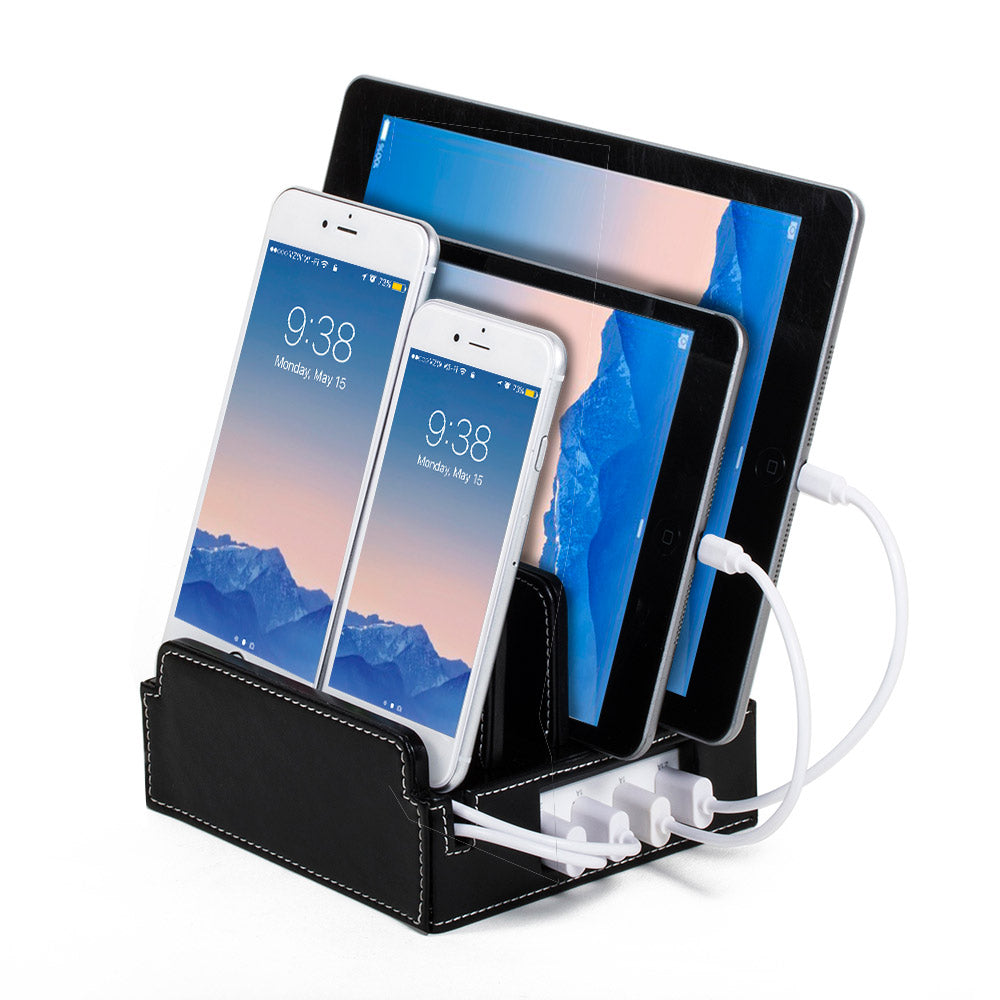 black leather charging station holds tablets phones upright while charging them includes smart power unit in base with rubber bumpers on dividers