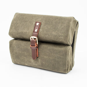 waxed canvas in olive green with brown leather buckle closure