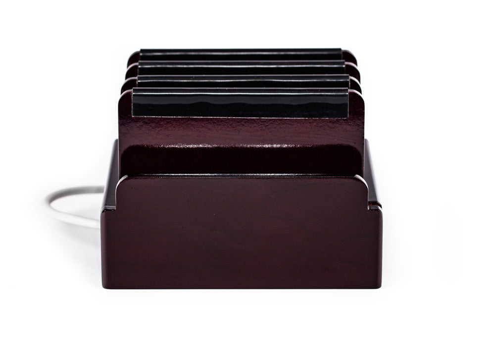 GLossy Cherry wood charging station with 4 dividers each with a rubber bumper on top.