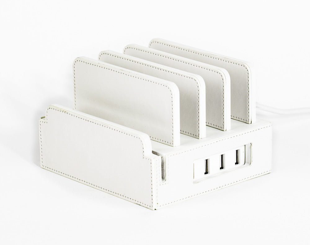 compact charging station holds 4 mobile devices upright and chargers them with built-in smart power unit white leather