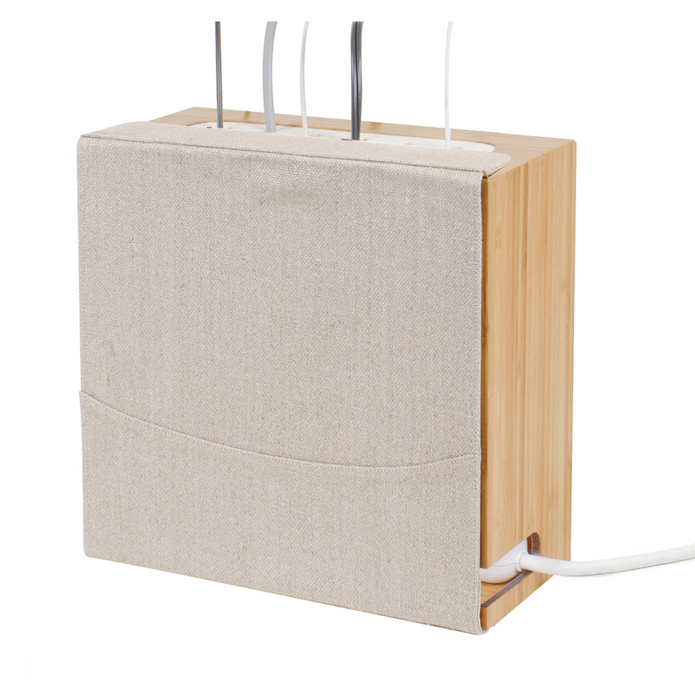 Bamboo and linen organizer holds power strip and excess cord under desk