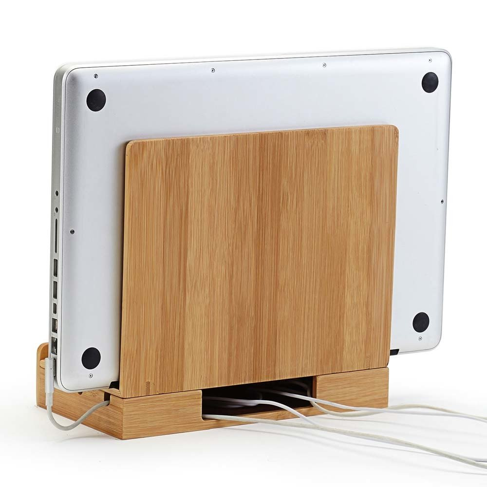 bamboo charging station holds laptop tablet phones upright while charging them and organizing cords underneath