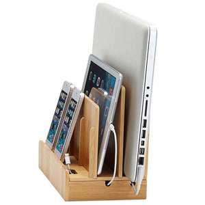 eco-friendly bamboo charging station holds laptop tablet phones upright while charging them and organizing cords underneath