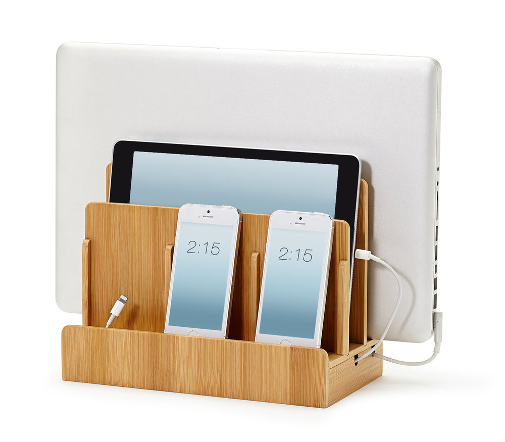 bamboo organizer holds laptop tablet phones upright while charging them and organizing cords underneath