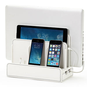 white leather organizer holds laptop tablet phones upright while charging them and organizing cords underneath