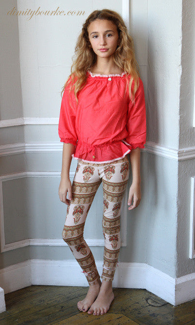 Designer leggings in stretch cotton jersey spandex in orange blossom signature print with button and bow details at cuff