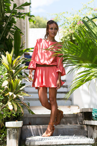 Cannes dress in luxuriously soft coral silk satin.