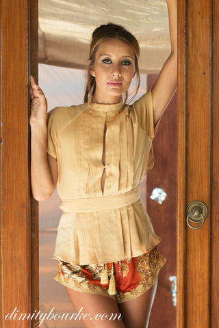 Effortlessly stylish French shorts in luxuriously soft silk satin golden peach print with lace details.