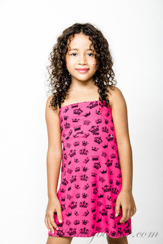 Girls playful cotton jersey cross over designer dress with navy bow at the back in hot pink with navy crown print