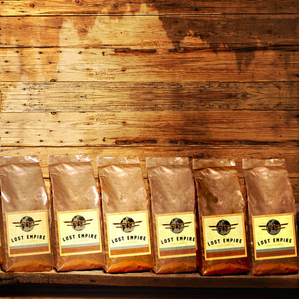 Our beautiful 12 oz valve copper foil bags look great displayed in view of your customers.       One unit is our wholesale minimum order of (6) 12 oz bags of this variety.  Expedition Espresso Roasted-to-Order      Organic & Fair Trade      Roasted-to-Order     Central American Blend of Fresh Roasted Coffees     (6) 12 oz copper foil valve bags, whole bean, espresso ground or auto-drip ground  Expedition Espresso Organic & Fair Trade Coffee Certified Organic & Fair Trade Fresh Roasted Espresso Blend Coffee      Our unique Expedition Espresso is a medium to dark roast and can be used for espresso drinks and for brewing.  Roast: Medium/Dark  Expedition Espresso is a amazing flavor profile blend for those who love dark coffee, without the bitterness typical of dark roasts. It is full-bodied, robust, and earthy. A unique, rich blend of Central American and African Coffees.  Tasting Notes: Sweet molasses, ginger and chocolate. Dark Chocolate aroma, sweet molasses and wine like berry notes with exotic sweet spices on the finish.  Lost Empire Coffee Company brings you the most exotic coffees and unique blends you have ever tasted.  We fresh roast our adventure brews and get them to you fast and fresh by foot, bicycle, train, balloon, truck or air. The closest thing to airdropping a wooden crate of fresh roasted coffees onto your lawn. Lost Empire Coffee is...Adventure. In a cup.